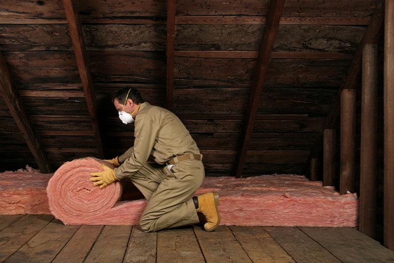 Tech installing insulation